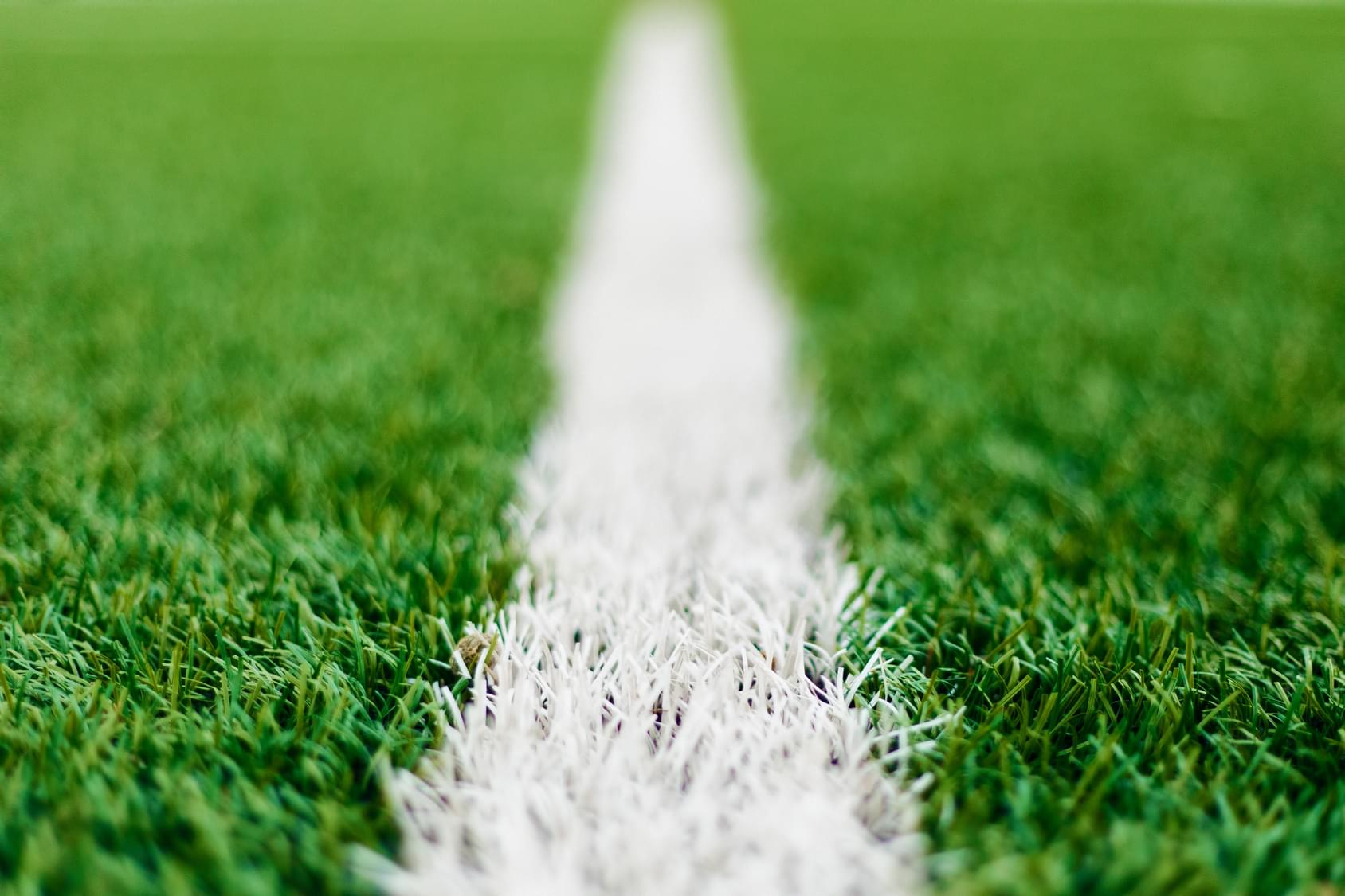 White line on a green soccer field illustrating the Football Euro Cup