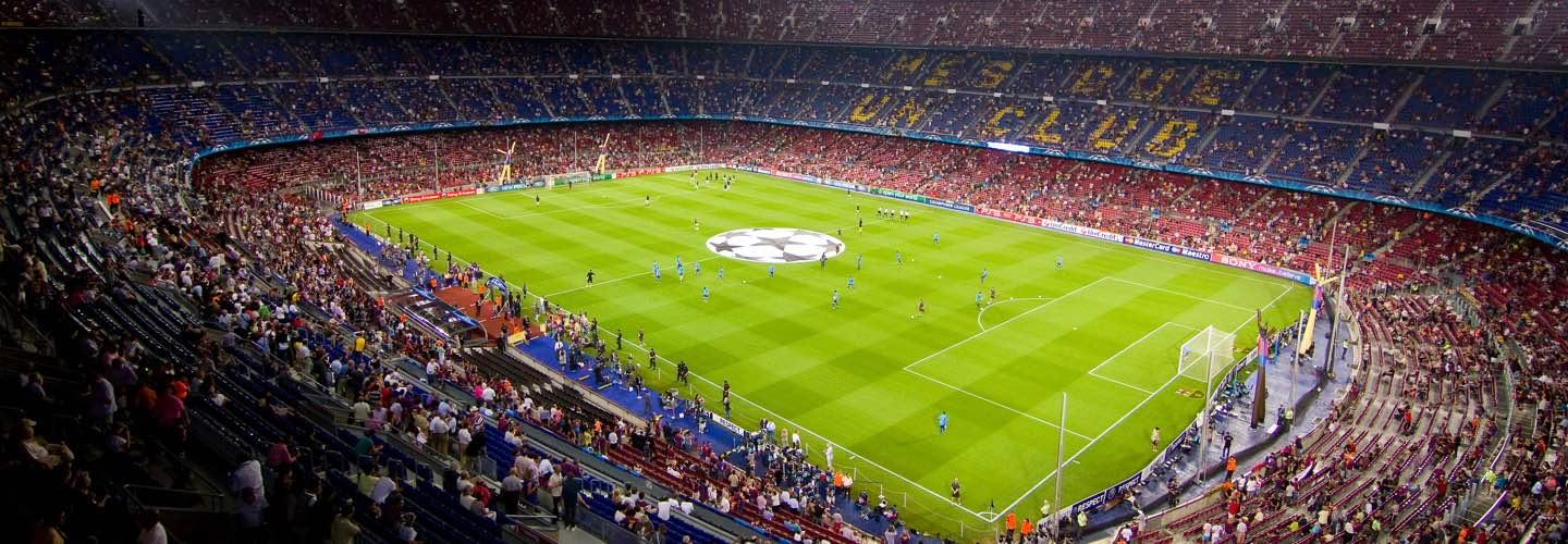 Stadium of the UEFA Champions League Final in Berlin with people in the stands by night