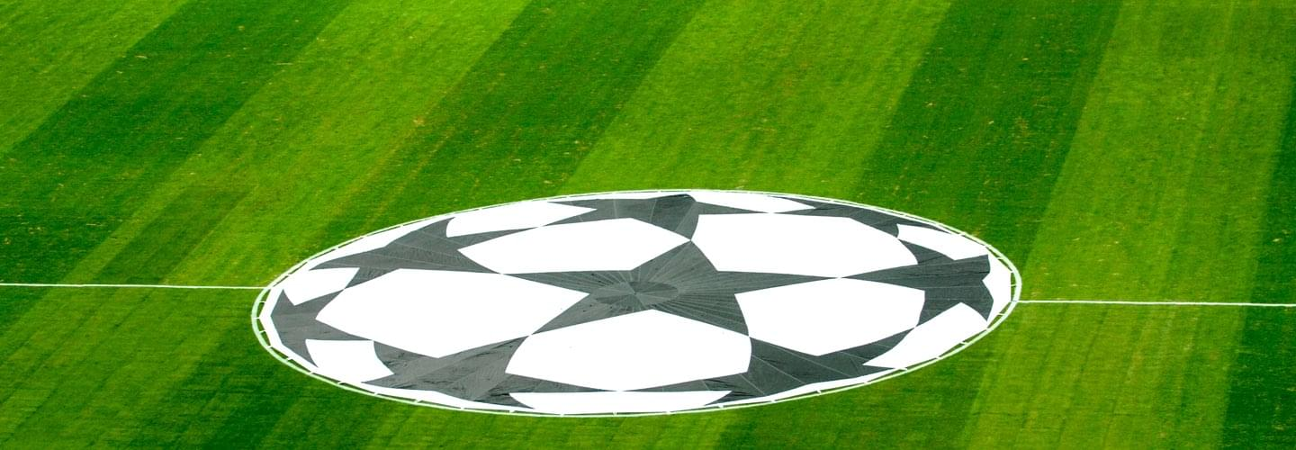 Green football field of the UEFA Super Cup in Tbilisi with the logo in the center