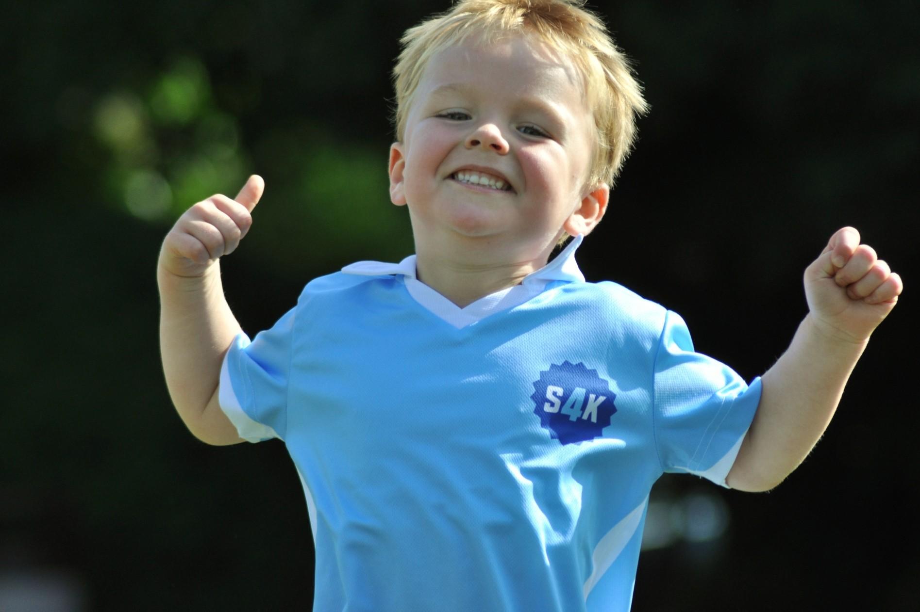 a child enjoying sport4kids class