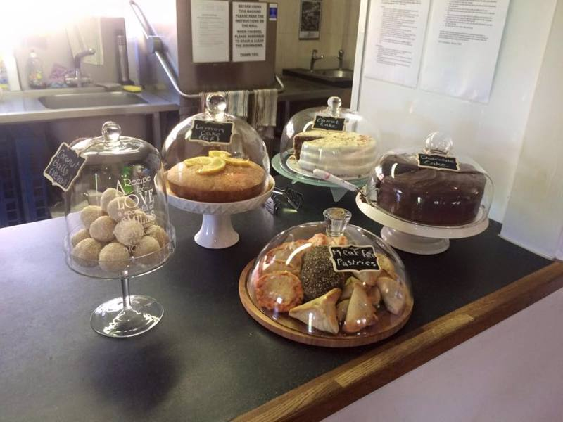 Yummy cakes and pastries in glass cake stands