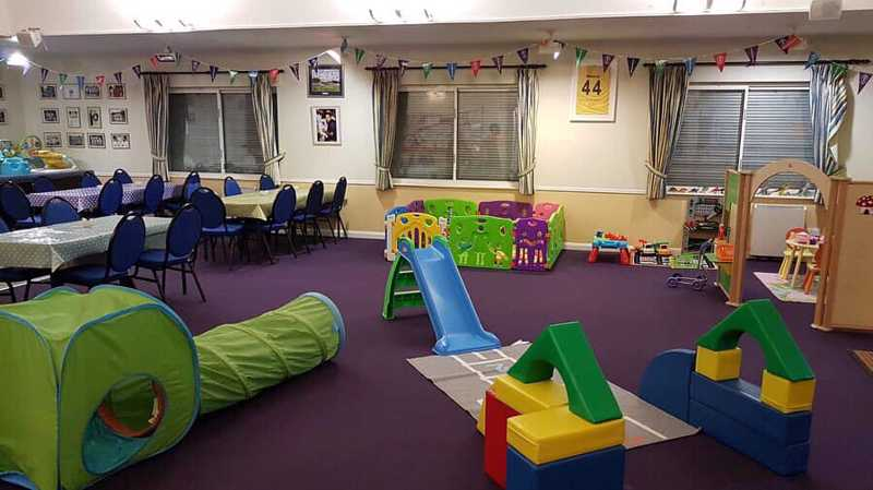 Cafe filled with soft play equiptment and slides