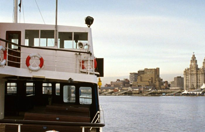 A ferry on the Mersey with Liverpool in the background