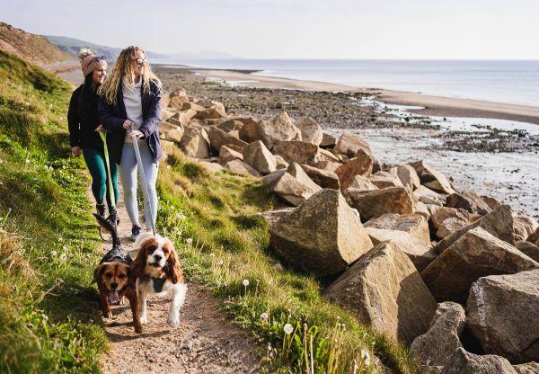 Rachel and Derbiled walking on Glen Whyllin beach