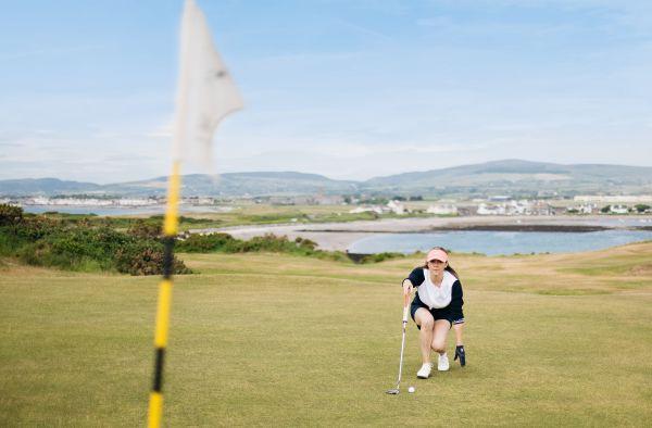 Helen Crosbie playing Golf