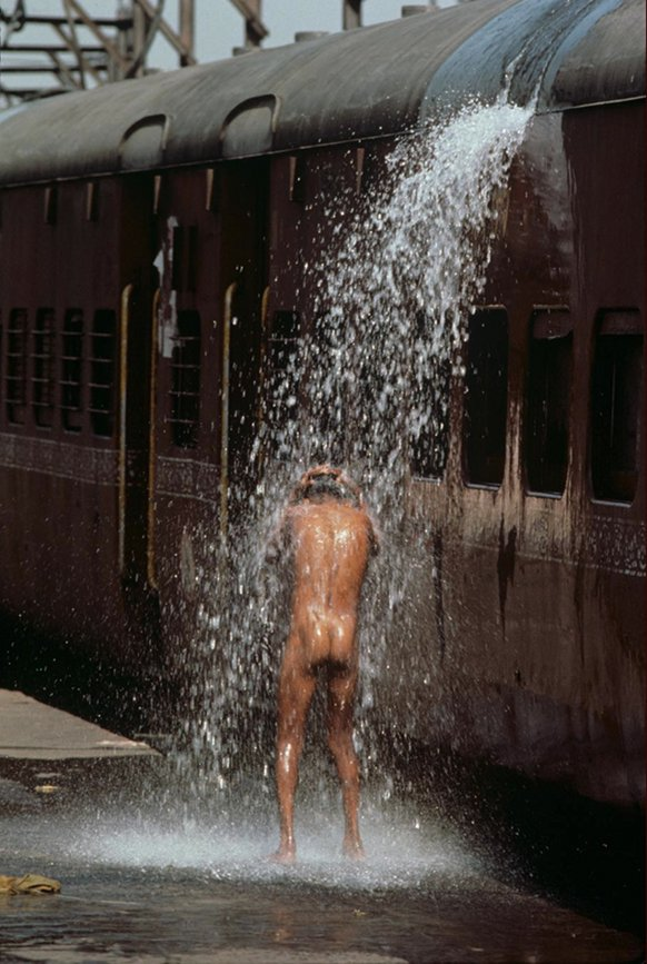 Man bathing at staion,Bombay, India, 1984