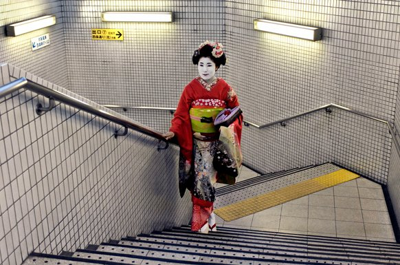 Geisha in subway, Kyoto, Japan, 2007