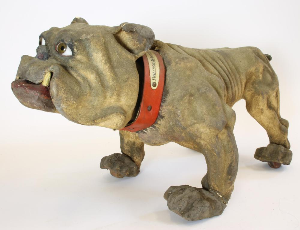 Lot 208 - Miscellaneous Toys & Games. A late Victorian British Bulldog pull-along toy, flock finish, papier