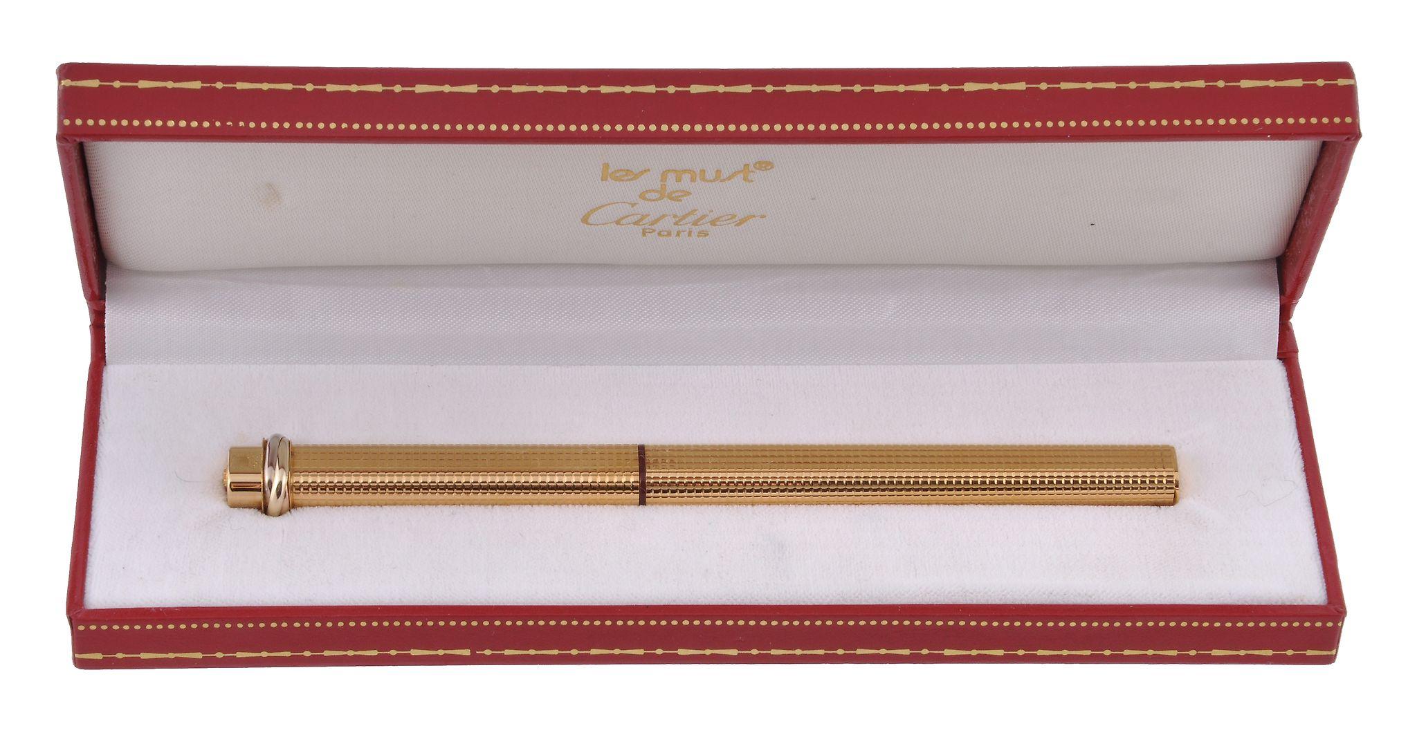 Lot 370 - Cartier, Must de Cartier, Vendome, a gold plated fountain pen Cartier, Must de Cartier, Vendome, a