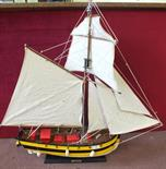 """A wooden model of a sailing ship, length 34"""""""