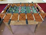 A table football game on a stand