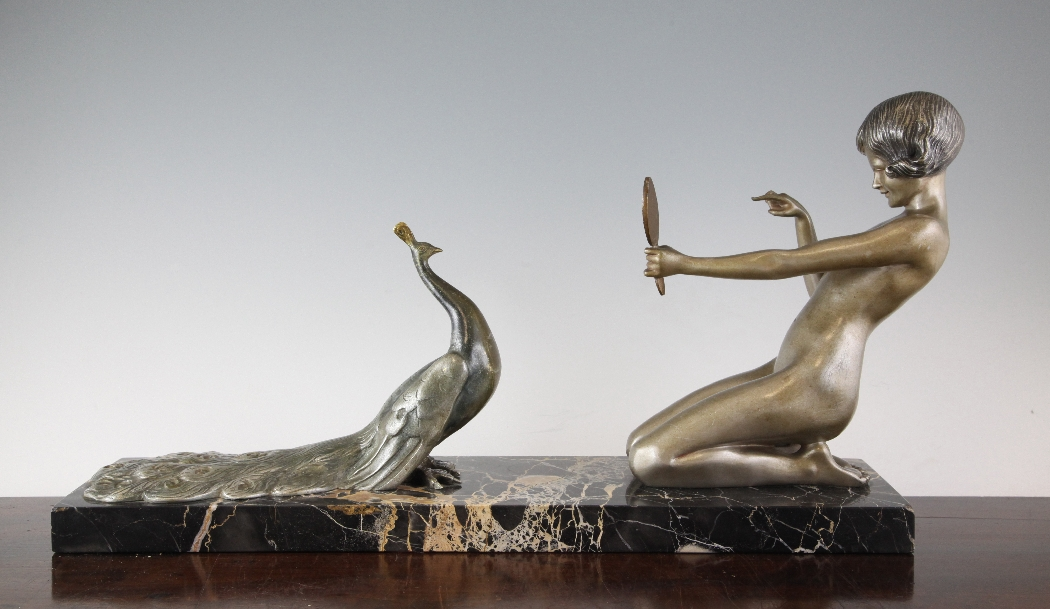 Lot 232 - Désiré Grisard. An Art Deco bronze and marble group of a nude maiden and a peacock, signed on marble