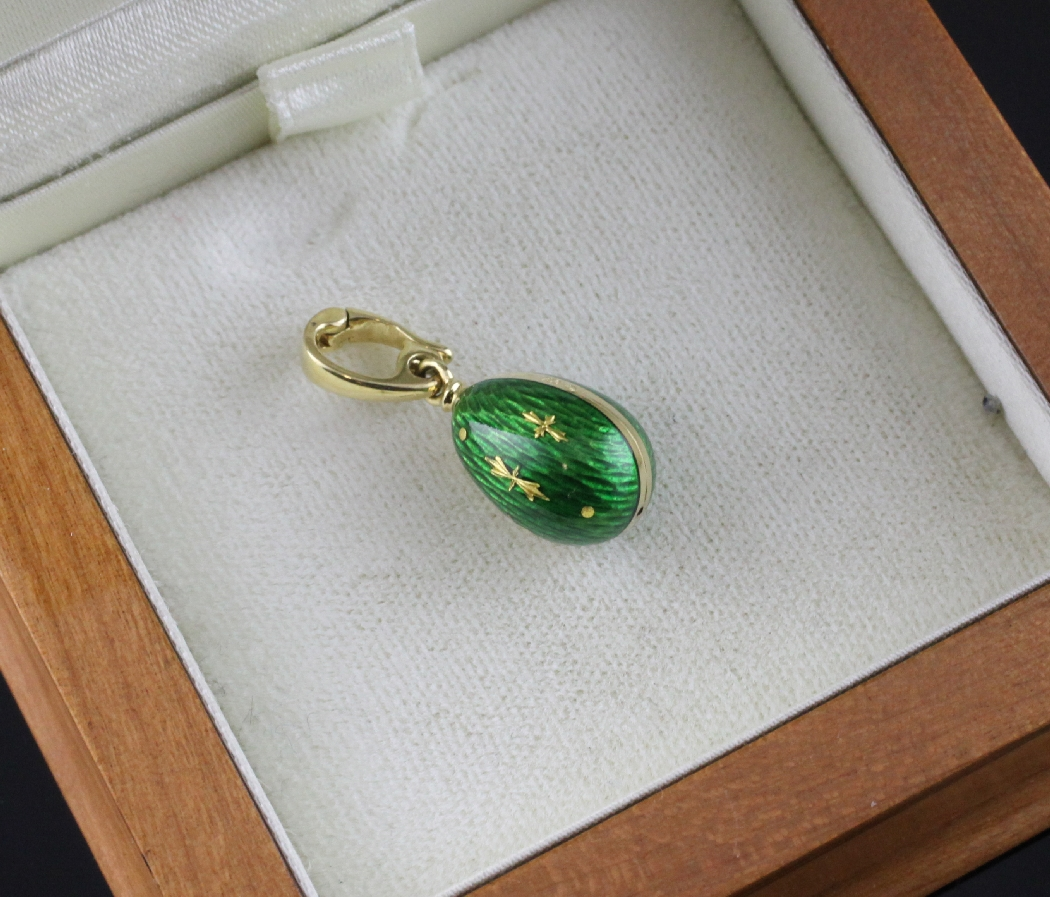 A modern 18ct gold and green guilloche enamel egg pendant by lot 1084 a modern 18ct gold and green guilloche enamel egg pendant by victor mayer aloadofball Images