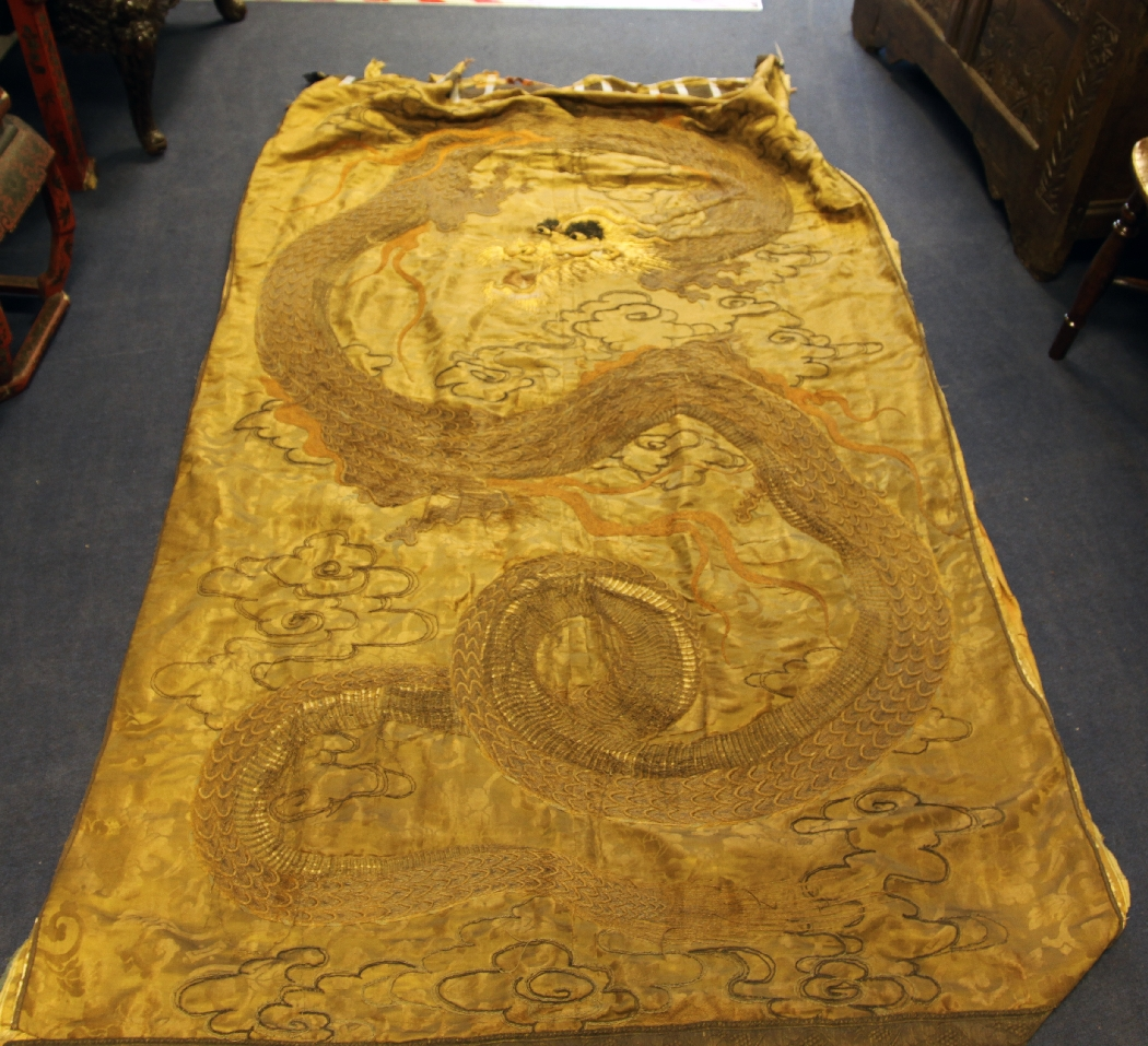 A Japanese embroidered silk and metal thread `dragon` wall hanging ...