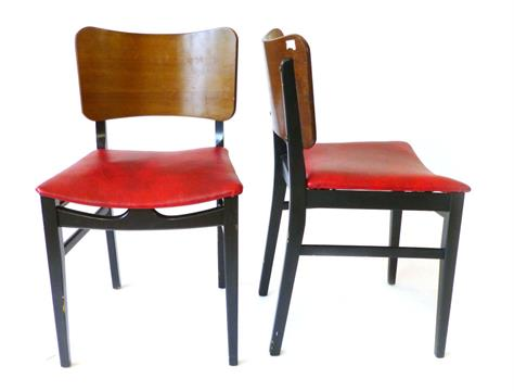 A Set Four Beautility Teak And Ebonised Wood Framed Dining Chairs With Red Vinyl Upholstered Seat