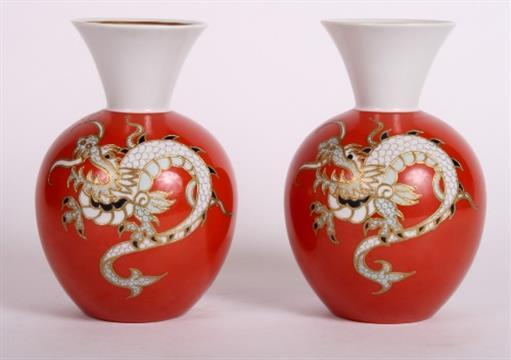A pair of Wallendorf porcelain bulbous vases decorated