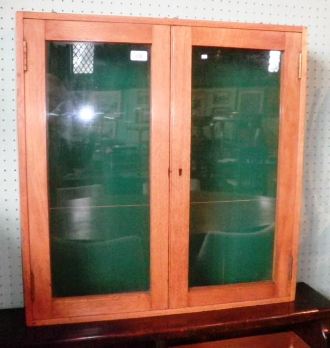 Lot 336 - An Edwardian oak notice board having a pair of glazed doors & An Edwardian oak notice board having a pair of glazed doors ...