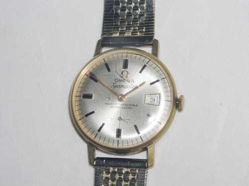 Lot 794 - A gentleman`s 18 ct Gold Omega - Seamaster Wristwatch Ressort Incassable Antimagnetic - 16203 to