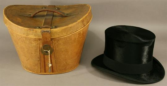 A 19TH CENTURY LEATHER TOP HAT BOX and a Christies` of London ... 3f95aa95dee