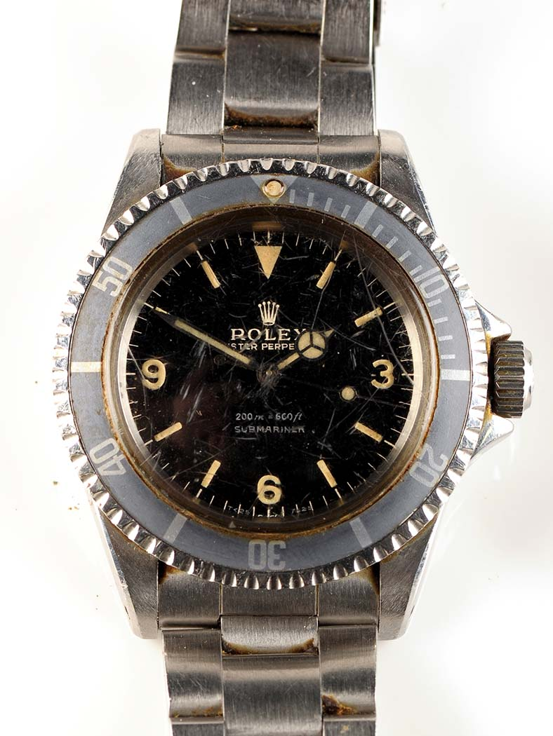 Lot 712 - A steel cased Rolex Oyster Perpetual Submariner, the black face with arabic and baton dial, fixed