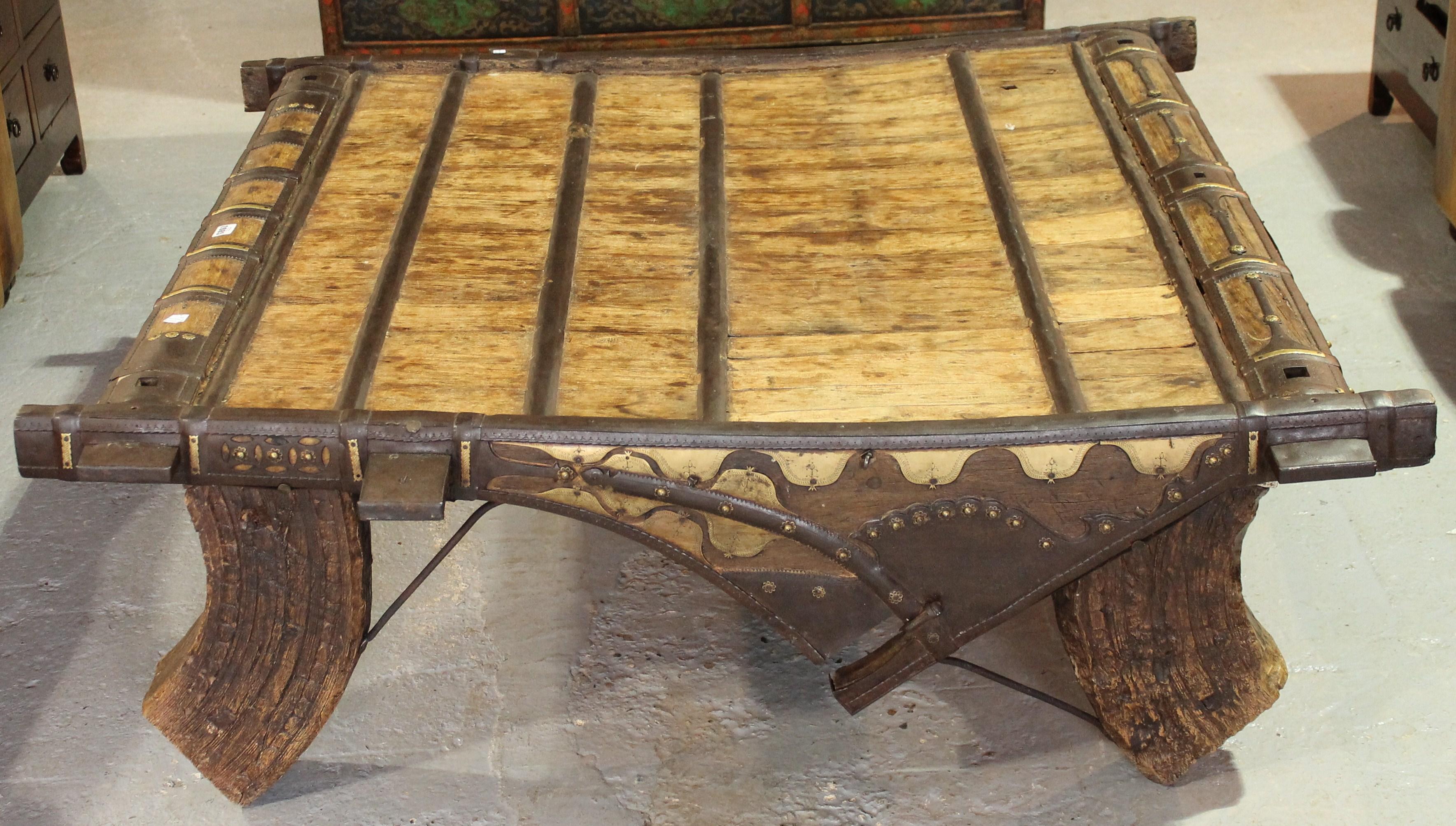A 19th century iron bound hardwood coffee table elephant saddle