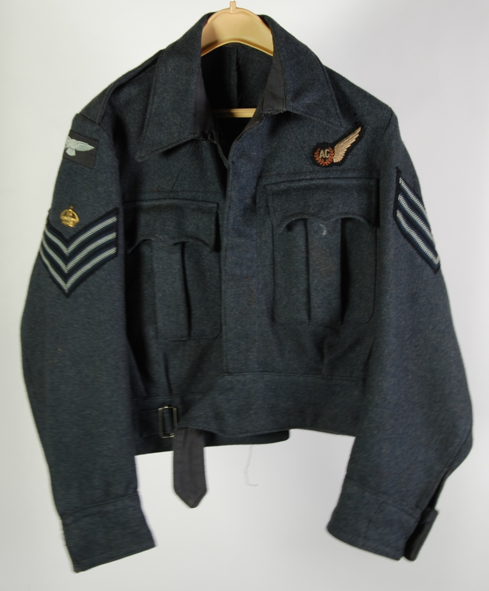 A CIRCA 1943 R.A.F WWII SERGEANTS BLUE SERGE FABRIC `BLOUSE` JACKET, with applied sergeants rank