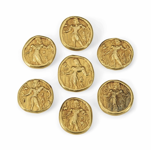 SEVEN GUPTA GOLD COINS MOUNTED AS BUTTONS INDIA, CIRCA 5TH CENTURY AD IN LATER MOUNTS Each obverse