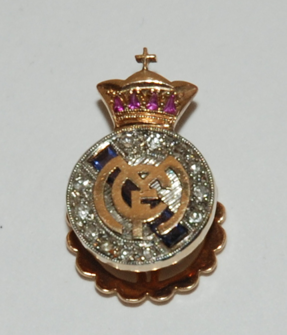 Lot 196 - An unusual diamond and gem set Real Madrid lapel badge in original fitted case