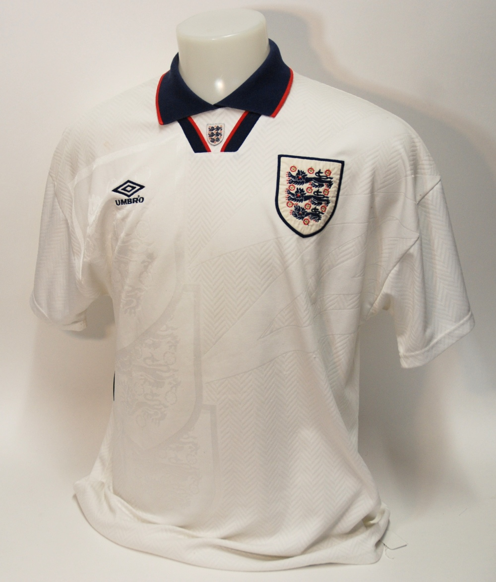 Lot 206 - A white England International short-sleeved shirt No.9, with v-neck collar and embroidered cloth