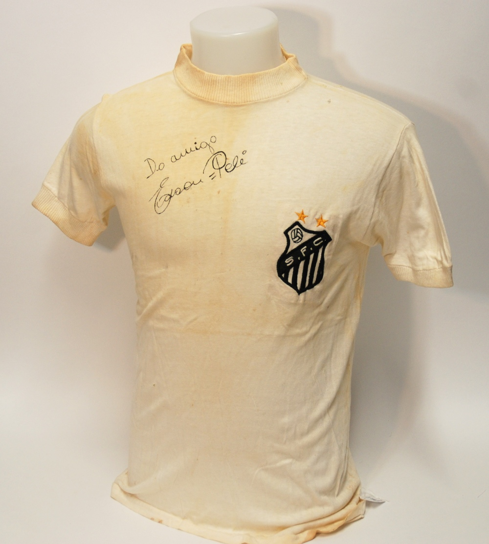 Lot 208 - A white Santos v. Bahia short-sleeved shirt No.10, with crew-neck collar and embroidered badge,