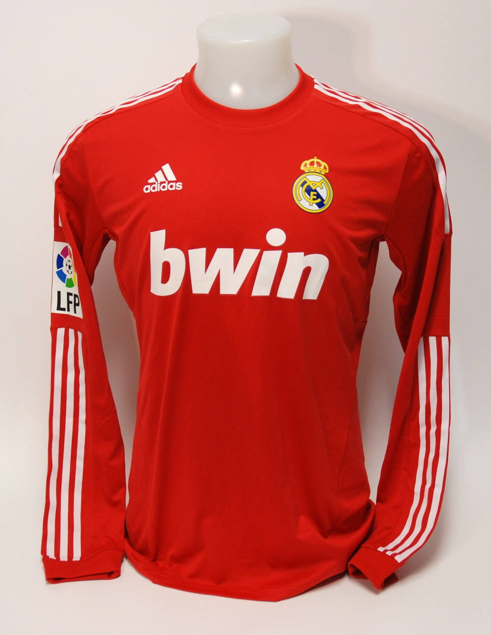Lot 208A - A red Real Madrid shirt No.7, with crew-neck collar and printed badge, the reverse lettered Ronaldo,