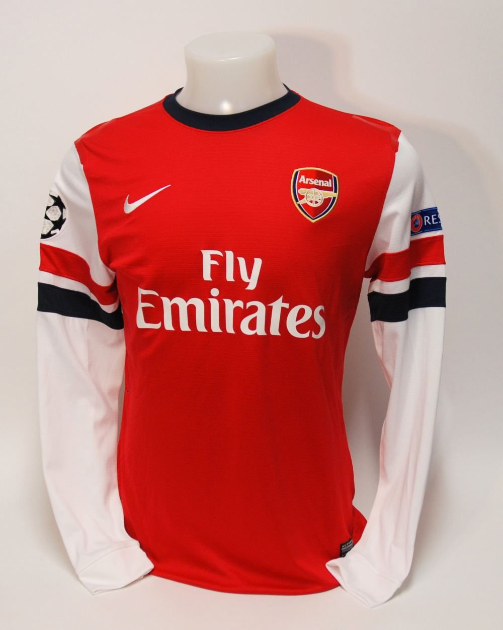 Lot 210 - A red Arsenal shirt No.15, with crew-neck collar and embroidered cloth badge, inscribed Arsenal, the