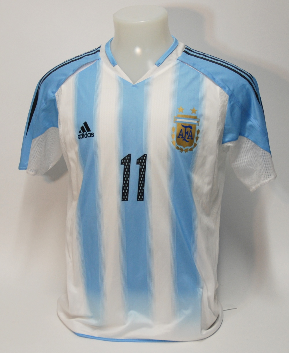 Lot 210A - A blue and white Coppa America Argentina International short-sleeved shirt No.11, with printed badge