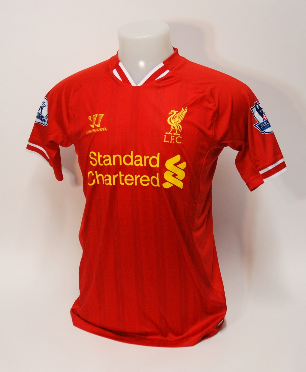 Lot 226A - A red Liverpool short-sleeved shirt No.7, with v-neck collar and embroidered badge, inscribed L.F.