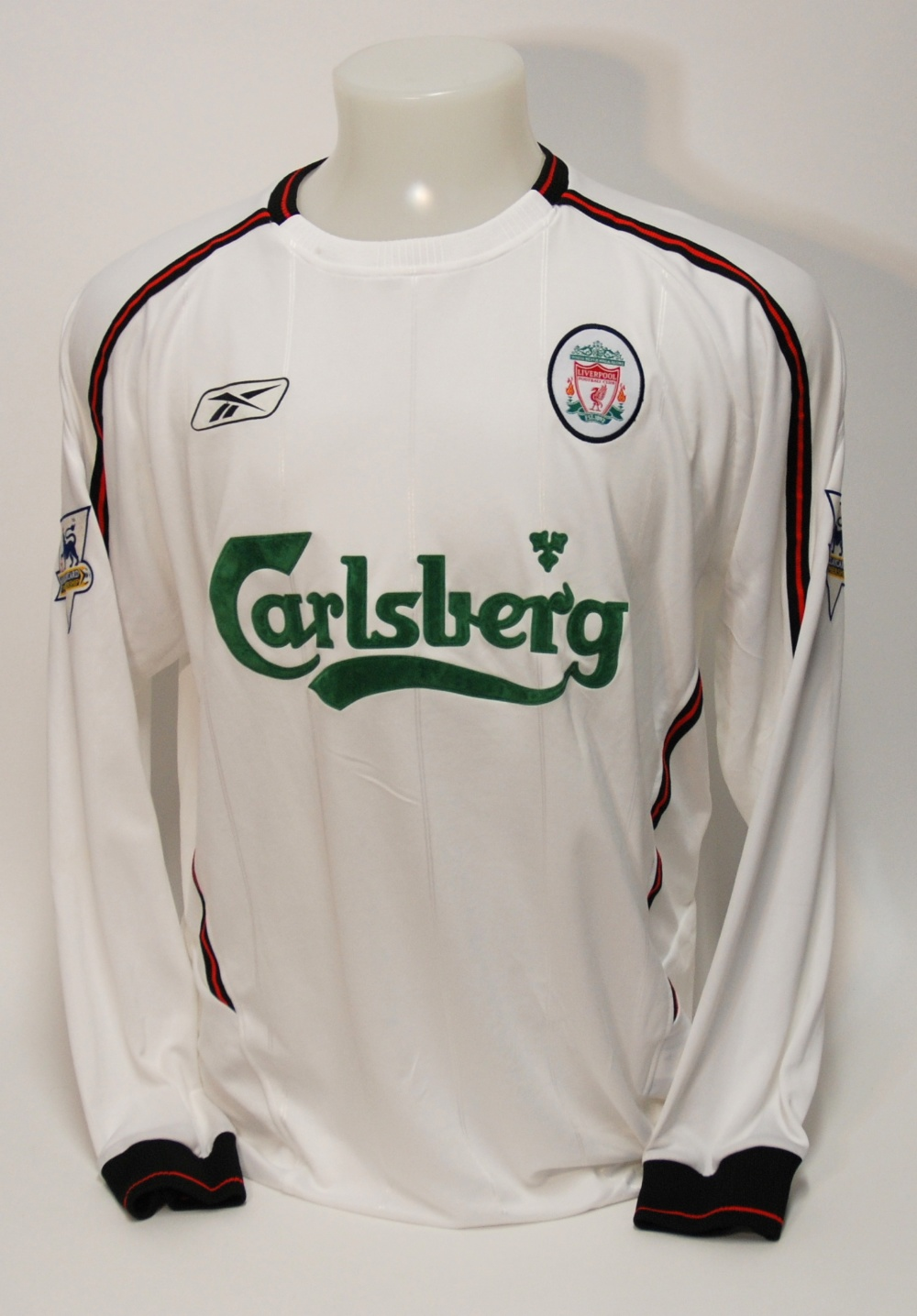 Lot 227A - A white Liverpool shirt No.8, with crew-neck collar and embroidered cloth badge, inscribed Liverpool