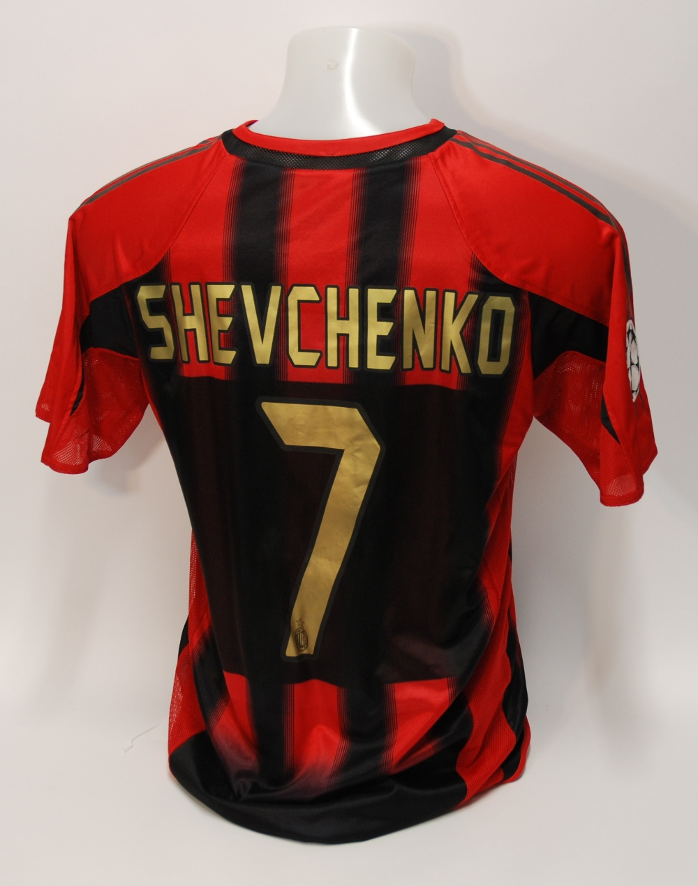Lot 228A - A red and black AC Milan short-sleeved shirt No.7, v-neck collar and embroidered cloth badge,