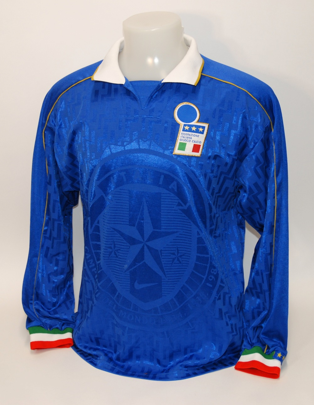 Lot 230A - A blue Italy v. Ukraine International shirt No.3, with v-neck collar and embroidered cloth badge,