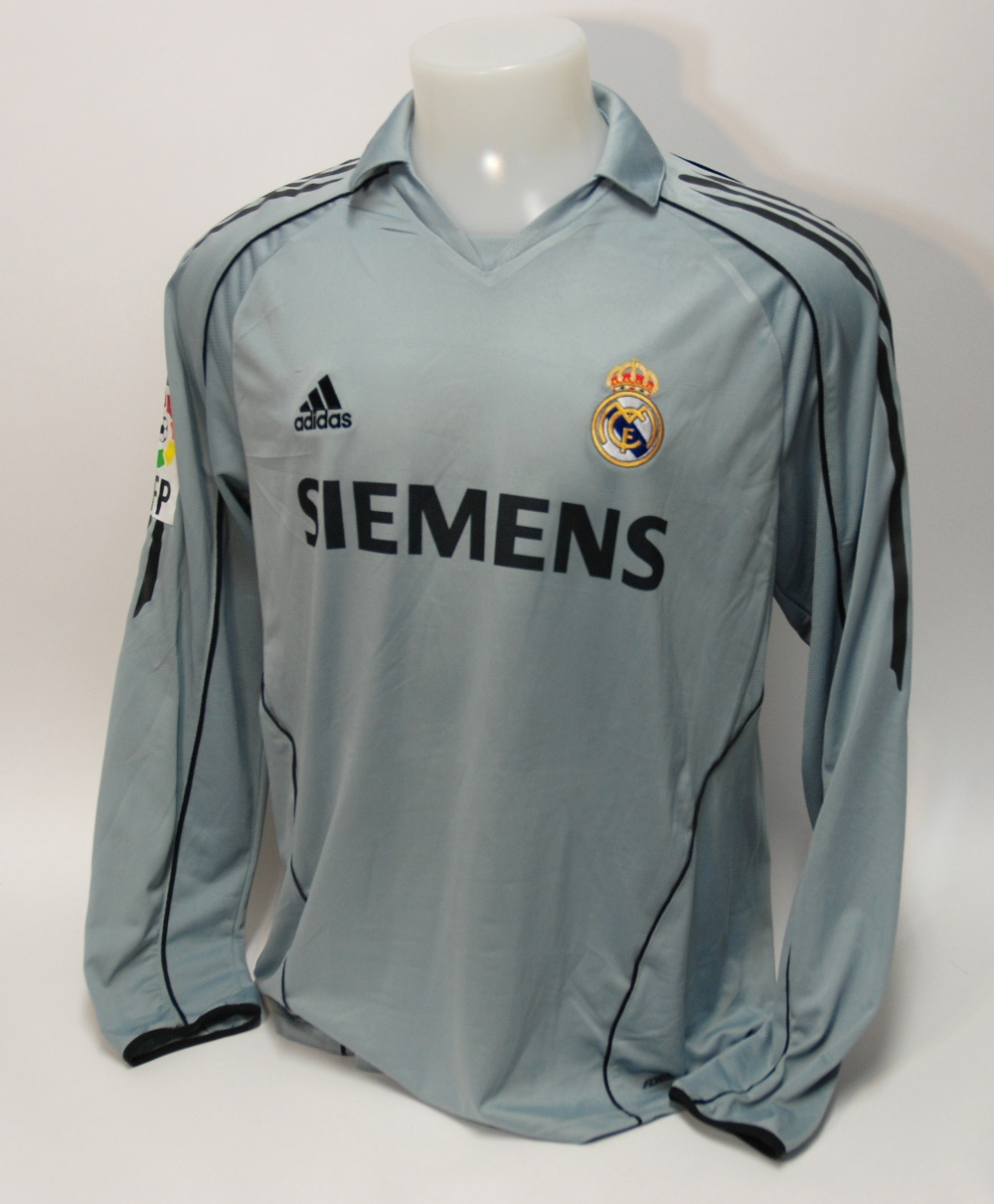 Lot 231A - A grey Real Madrid shirt No.23, with v-neck collar and embroidered badge, inscribed FCM, the reverse