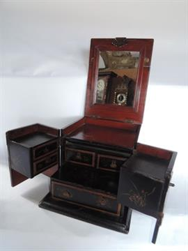 A Black Lacquered Japanese Dressing Table Box With Rising Mirror, Hinged  Front And Fitted Interio