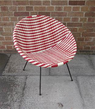 A WOVEN PLASTIC CHAIR Circa Late 1950s / Early 1960s, In Red And White Basket  Weave, On A Black
