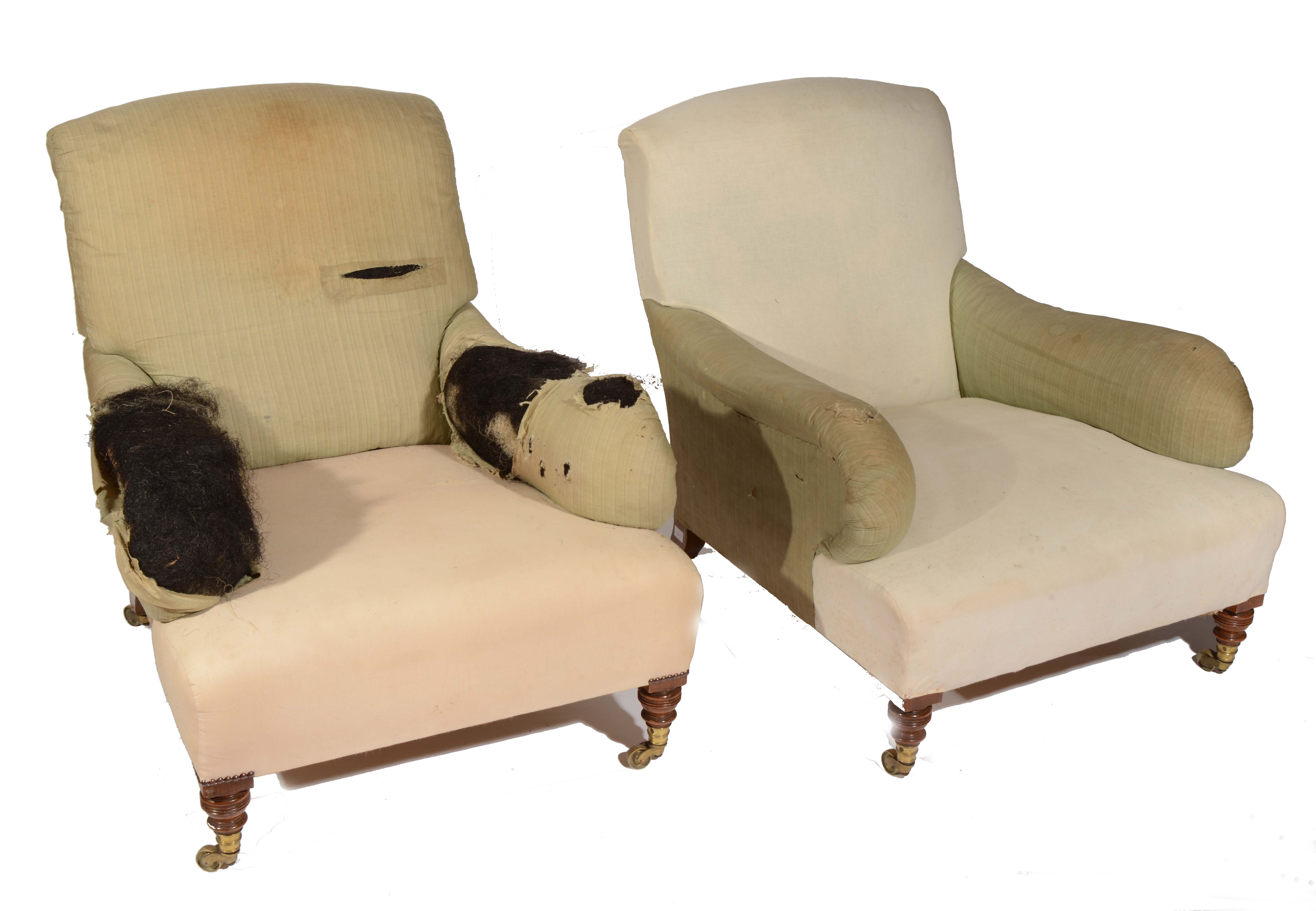 A PAIR OF HOWARD & SONS GRAFTON PATTERN ARMCHAIRS on ring turned mahogany forelegs and with original