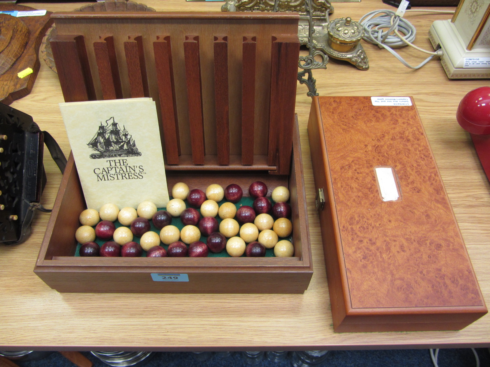 Lot 249 - Sailor's dice box and 'The Captain's Mistress' game