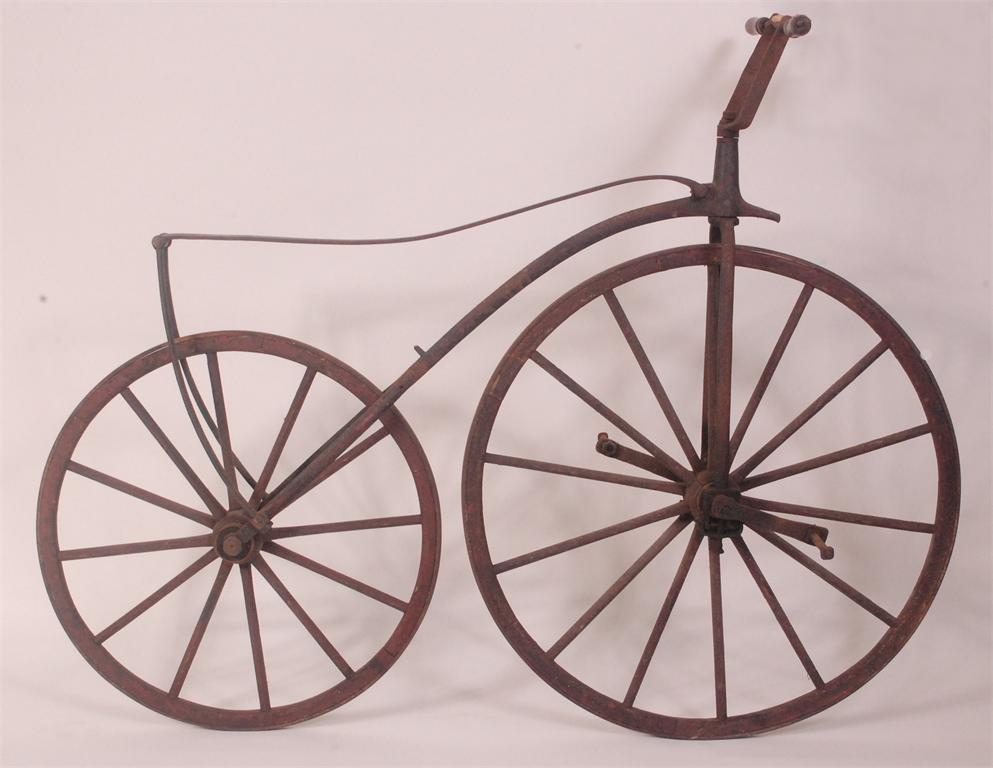 Lot 568 - A mid-Victorian 'bone-shaker' or velocipede, circa 1860-1870, having black and red painted wooden