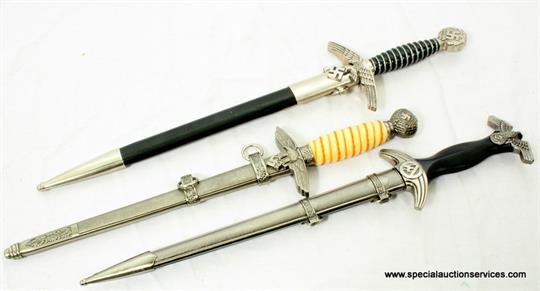 Three replica German daggers, including a 2nd model Luftwaffe dagger (3)