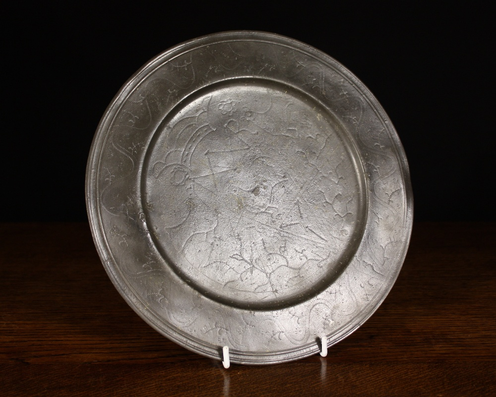 Lot 395 - An Antique Pewter Plate with wriggle work decoration and a multi-reeded & An Antique Pewter Plate with wriggle work decoration and a multi ...