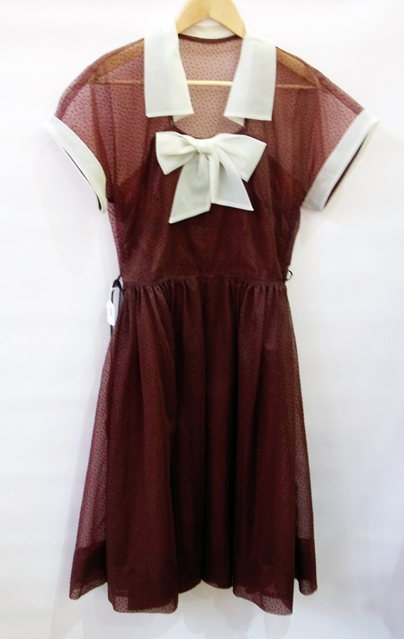 A Poplin vintage brown dress with white chiffon sleeves and collar with bow to bodice with a brown