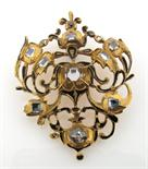 Lot 1539 - A diamond set gold jewel, probably late 17th or early 18th Century. Of pierced foliate scroll form