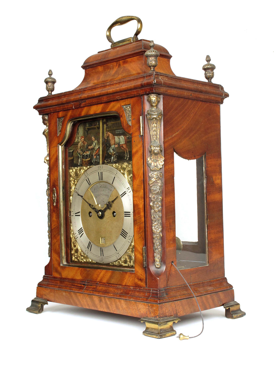 Lot 129 - A George III striking mahogany bracket with automaton, the 7 inch brass dial signed on a recessed