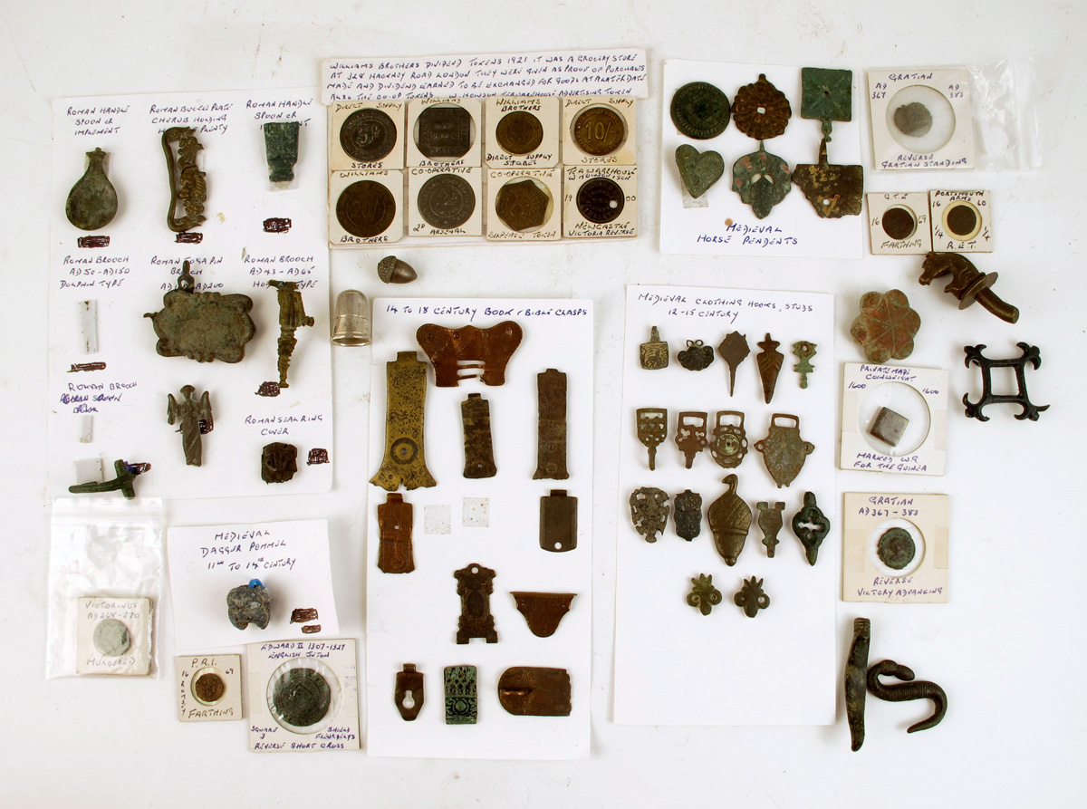 A small collection of metal artefacts, including book clasps