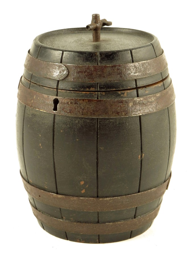 Lot 637 - A rare late 19th century French ebonised fruitwood wine barrel tea caddy, with an iron tap and